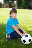 Little boy in cap with soccer ball Royalty Free Stock Photos