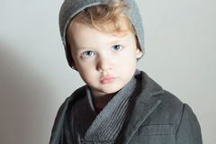 Little Boy in cap.Stylish Handsome Child. Fashion Kids. in sweater.sad Stock Photos