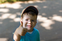 Little boy in cap victory sign Royalty Free Stock Photo