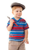 Little boy in cap with wrench Royalty Free Stock Photography