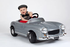 Little boy in a car Stock Image