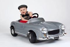 Little boy in a car. Little boy sitting in a toy car stock image