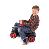 Little boy with car. Young little boy driving his car Royalty Free Stock Photo