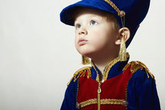 Little Boy in Carnival Costume.Fashion Children.Handsome Kid with big blue eyes. Masquerade Soldier.Unusual Uniform Royalty Free Stock Photos