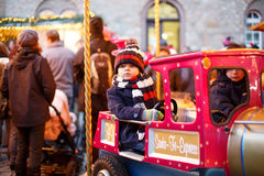 Little boy on a carousel at Christmas market, outdoors Stock Photography