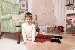 Little boy on carpet in Christmas interior Stock Photo