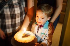 Little boy carrying birthday cake Royalty Free Stock Photography
