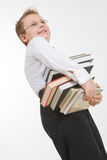 Little boy carrying books stack Royalty Free Stock Images
