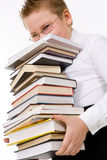 Little boy carrying books stack Stock Photography