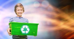 Little boy carrying recycle container Stock Images