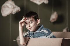 Little boy in carton box Royalty Free Stock Images