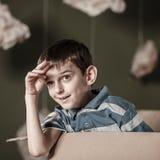 Little boy in carton box Stock Photo