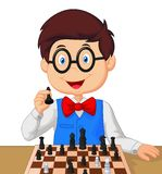 Little boy cartoon playing chess Stock Images
