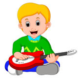 Little boy cartoon playing guitar Stock Photography