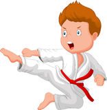 Little boy cartoon training karate Royalty Free Stock Photos