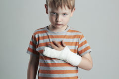 Little boy in a cast.child with a broken arm.kid after accident Royalty Free Stock Photo