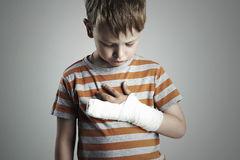 Little boy in a cast.child with a broken arm.kid after accident Stock Photos