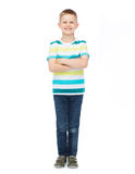 Little boy in casual clothes with arms crossed. Happiness, childhood and people concept - smiling little boy in casual clothes with crossed arms Stock Photography
