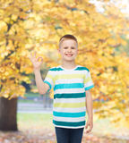 Little boy in casual clothes making OK gesture Royalty Free Stock Photos