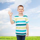 Little boy in casual clothes making OK gesture Royalty Free Stock Images