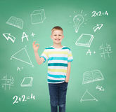 Little boy in casual clothes making OK gesture Stock Photo