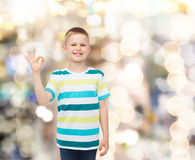 Little boy in casual clothes making OK gesture Stock Photography