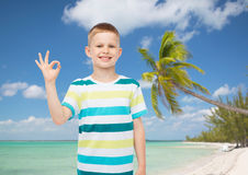 Little boy in casual clothes making ok sign Royalty Free Stock Photo