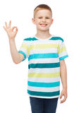 Little boy in casual clothes showing OK gesture Stock Image