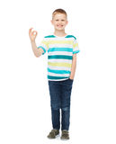 Little boy in casual clothes showing OK gesture Stock Images