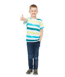 Little boy in casual clothes showing thumbs up Royalty Free Stock Image