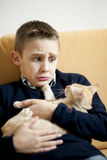 Little boy with cat Stock Photo