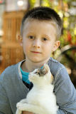 Little boy with cat Stock Image