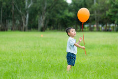 Little boy catch balloon. Little boy catch with balloon royalty free stock photos
