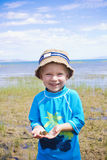 Little Boy catching Frogs at the Lake Royalty Free Stock Image