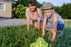 Little boy catching insects with his mother Royalty Free Stock Photo