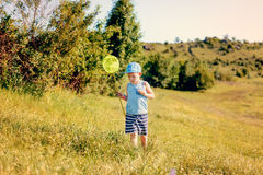 Little boy catching insects Royalty Free Stock Photography