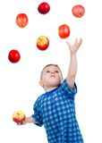 Little boy  caughts flying apple Stock Photography