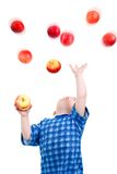 Little boy  caughts flying apple Stock Photo