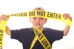 Little boy caution do not enter. Isolated on white Stock Photos