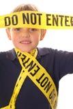 Little boy caution do not enter vertical. Shot of a little boy caution do not enter vertical Stock Image