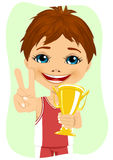 Little boy celebrates his golden trophy Royalty Free Stock Photos