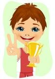 Little boy celebrates his golden trophy Royalty Free Stock Photos