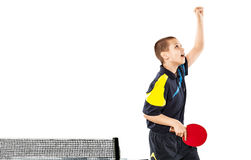 Little boy celebrating flawless victory in table tennis isolated. Portrait Of Kid celebrating flawless victory in table tennis isolated on white background stock photo