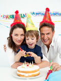 Little boy celebrating his birthday at home. With his parents Stock Images