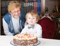 Little boy celebrating his birthday  with his grandmother Stock Image