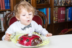 Little boy celebrating third birthday and blowing off  candles Stock Images