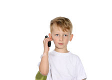 Little boy on a cell phone. Toddler listening on a cell phone looking intently at the camera stock image
