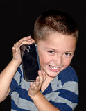 Little boy with  cell phone Stock Photo