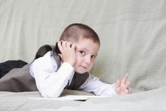 Little boy with cellphone and book Royalty Free Stock Photo