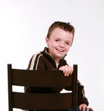Little boy in chair Stock Image